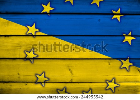 Ukraine and EU Flag on wood background