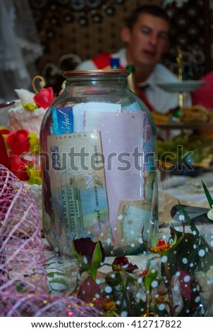 UKRAINE, HERSON - SEPTEMBER 21/2013: in the village Ukrainian wedding was held at a local tradition with a large number of guests. - stock photo