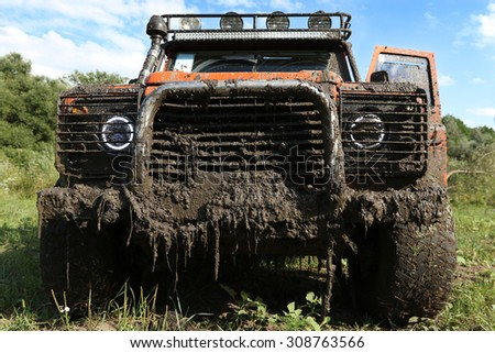 UKRAINE - JULY 28 - fornt side of Land Rover Defender in nature covered in mud on July 28, 2015 in Ukraine.