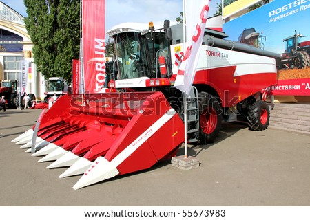 "UKRAINE, KIEV - JUNE 16: XXII International agro-industrial exhibition ""AGRO 2010"". June 16, 2010 in Kiev, Ukraine. Red harvesting machine"