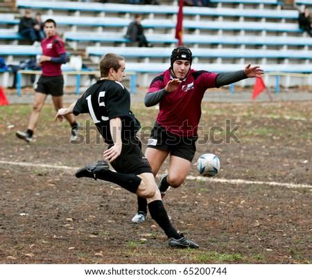 UKRAINE, KIEV - NOVEMBER 6 : Rugby players in action at a Ukrainian National Championship rugby match, Antares vs. Eger, November 6, 2010 in Kiev, Ukraine. - stock photo