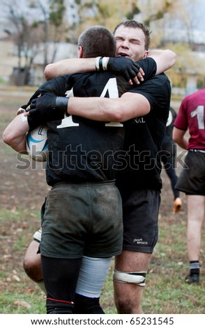 UKRAINE, KIEV - NOVEMBER 6 : Rugby players in action at a Ukrainian National Championship rugby match, Antares vs. Eger, November 6, 2010 in Kiev, Ukraine. ANTARES(In Black) vs EGER(In Red) - stock photo