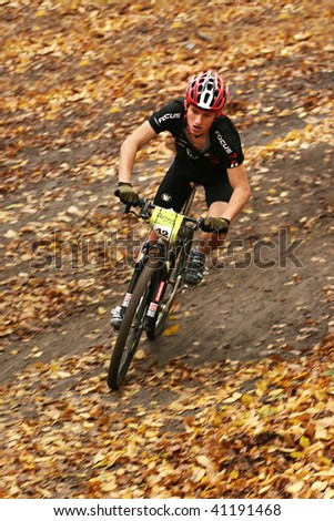 "UKRAINE, KIEV - OCTOBER 24: Bogomolov Pavel professional biker with blurred background, at the professional bicycle competition ""Dubki"" closing, on October 24, 2009 at Ukraine, Kiev."