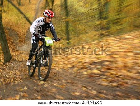 "UKRAINE, KIEV - OCTOBER 24: Pogrebenko Andriy professional biker with blurred background, at the professional bicycle competition ""Dubki"" closing, on October 24, 2009 at Ukraine, Kiev. - stock photo"