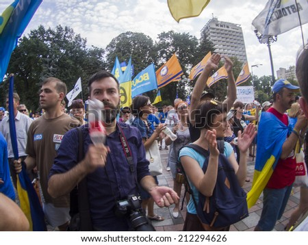 UKRAINE, KYIV - 12 Aug, 2014:  People require lustration in Parliament. Hundreds of people gather by the Ukrainian Parliament to demand the lustration - expose and ban supporters of the former regime