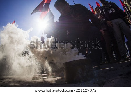 "UKRAINE, KYIV - October 2, 2014:  ""Right sector"" lit smoke bomb at CEC -- Ultranationalists of ""Right sector"" required to exclude from the list of block of Petro Poroshenko of the former Regionals"