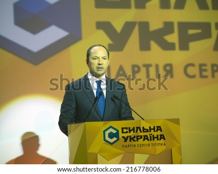 "UKRAINE, KYIV - September 11, 2014: Sergey Tigipko speaks to delegates to the Congress of party ""Strong Ukraine"". Congress delegates approved a program and the list of candidates in majority districts - stock photo"