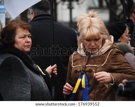 UKRAINE, LUGANSK - February 16, 2014: Evromaidan activists. Anti-government rally is traditionally held in the center of Lugansk near the monument dedicated to poet Taras Shevchenko.