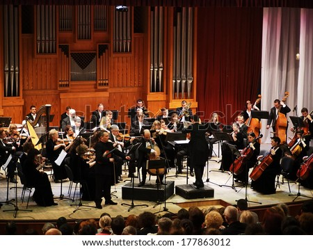 UKRAINE, LUGANSK - February 20, 2014: Lugansk Symphony Orchestra gave a concert. The conductor of the orchestra was Sergey Chernyak, Soloists  - Taras Mentsynsky and Yuri Kirichenko - stock photo
