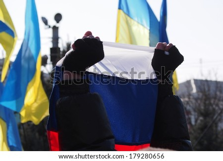 "UKRAINE, LUGANSK - March 1, 2014: Supporters of the old regime rally ""against anarchy and disorder"". The rally soon turned to support the Russian occupation of Crimea - stock photo"