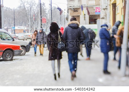 Ukraine, Lviv - JANUARY 6, 2015: Residents and tourists in the streets of Lviv. Lviv city buildings.