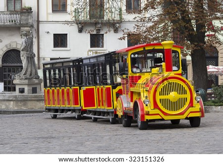 UKRAINE, LVIV - SEPTEMBER 28, 2015: A pleasure train at the central square of Lviv, Ukraine. It is a favourite vehicle to drive in and have a guided tour. - stock photo