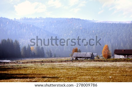 Ukraine, the village of Bukovel autumn. Mountain landscape. The village in the mountains in the early morning  - stock photo