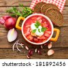 Ukrainian and Russian national Red Borscht on wooden surface, menu cooking recipes. Food, spices for cooking. - stock photo