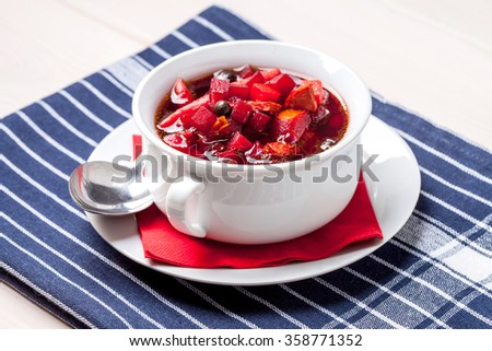 Ukrainian and russian national red borscht with vegetables and spice. - stock photo