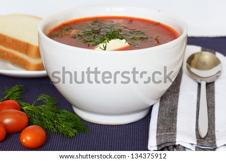 Ukrainian and russian national red soup-borsch with sour cream
