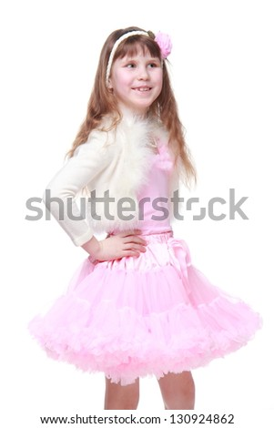 Ukrainian beautiful little girl with long healthy hair in a pink tutu on Beauty and Fashion
