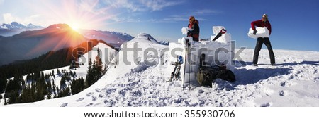 Ukrainian Carpathians - a mountain hike trains people to build the igloo - snow house like the Eskimos. safe haven during the winter storms hurricanes destroying unprotected tents - stock photo