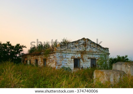 ukrainian old cottage rural vintage home house building architecture countryside abandoned  on sunset landscape field - stock photo