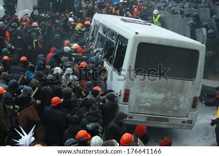 Ukrainian protesters break a police bus. Kyiv, Ukraine, January 19, 2014 - stock photo