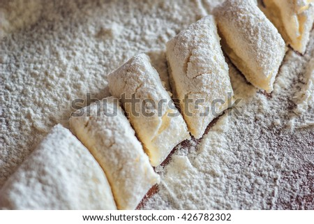 Ukrainian traditional lazy dumplings with cottage cheese. Belarusian and Ukrainian Cuisine. Process of making homemade dumplings on a floured board.,delicious lunch. - stock photo