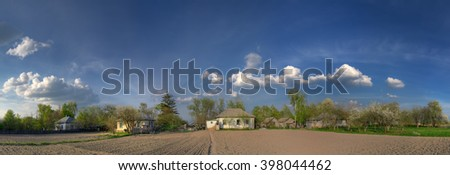 Ukrainian village. Rural houses and vegetable garden on foreground.  - stock photo