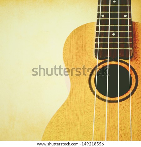 ukulele with copyspace and retro filter effect - stock photo