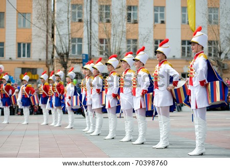 ULAN-UDE, RUSSIA - MAY 9: Young drummer girls at the parade on annual Victory Day, May, 9, 2010 in Ulan-Ude, Buryatia, Russia. - stock photo