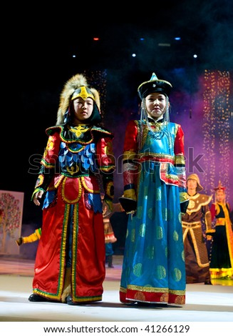 ULAN-UDE, RUSSIA - OCTOBER 29: Asian kid models demonstrate costumes in ethnic style at the international asian fashion festival on October 29, 2009 in Ulan-Ude, Buryatia, Russia.