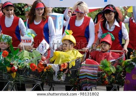 """ULAN-UDE, RUSSIA - SEPTEMBER 6: Unidentified employees (and their children) of the supermarket trading network """"Stam"""" take part in the City parade on annual City Day, September 6, 2008 in Ulan-Ude, Buryatia, Russia. - stock photo"""