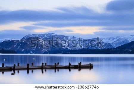 Ullswater Dusk.  The view across Ullswater at dusk from Pooley Bridge in the English Lake District National Park. - stock photo