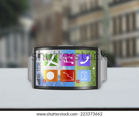 ultra-lightweight bent interface smartwatch horizontal with steel watchstrap on desk and street background - stock photo