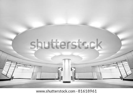 Ultra modern black and white public subway station - stock photo