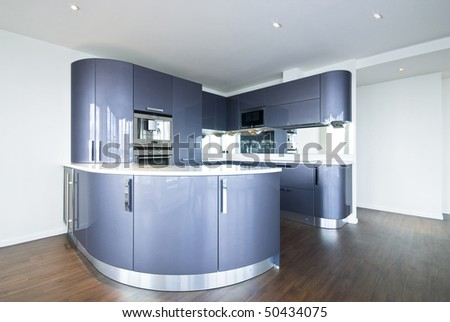 Ultra modern designer kitchen with modern appliances in metal blue and gray - stock photo