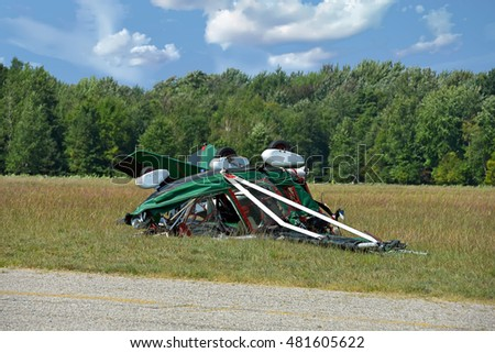 ultralight crash in rural field near airport runway