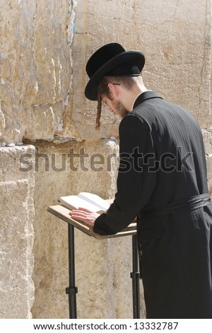 Ultraorthodox prays in the wailing wall in Jerusalem. - stock photo