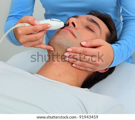 Ultrasonic hair removal in professional studio - stock photo