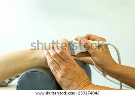 Ultrasound echo on the heel of woman's foot - stock photo