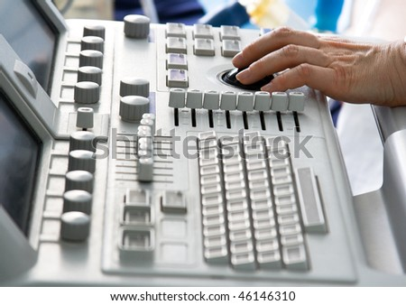 Ultrasound medical device keyboard with doctor's hand. Image with shallow DOF. - stock photo