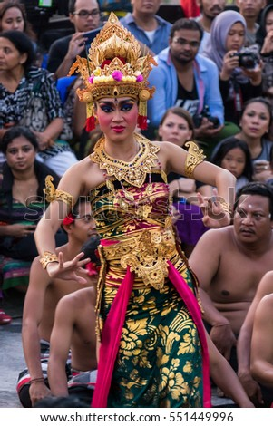 Uluwatu Bali, Indonesia - 22 July 2016 - Balinese woman performing the traditional Kecak dance at Uluwatu Temple, Bali. She is wearing a colorful dress and sophisticated golden ornament jewelry.