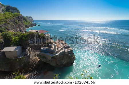UluWatu coastline with beaautiful rocky cliffs and turquoise wavey sea. - stock photo