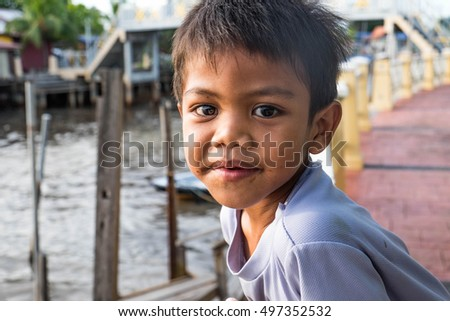 Umbai/Malaysia: 08th October 2016- Children are very excited and amazed with the fishermen village especially boats and fishes.