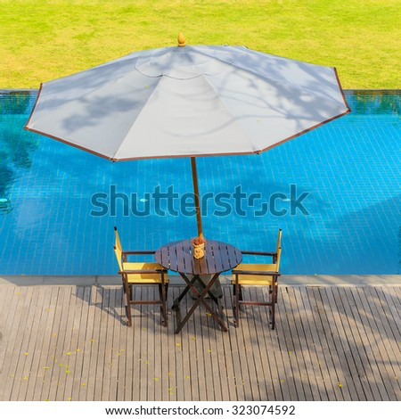 umbrella and chair at the swiming pool - stock photo