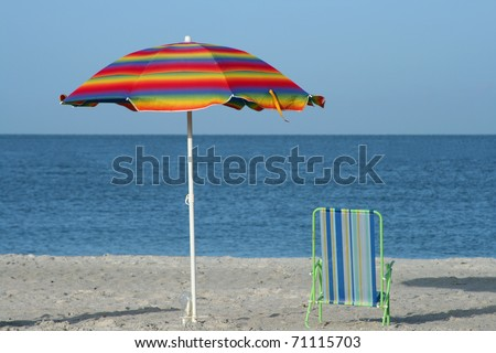 Umbrella and Chair on beach in Madeira Beach Florida - stock photo