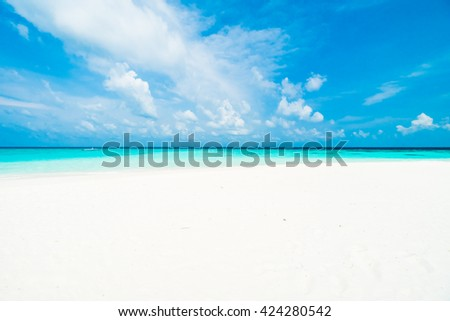 Umbrella and chair on the beautiful tropical beach and sea around hotel resort in maldives island - Boost up color Processing - stock photo