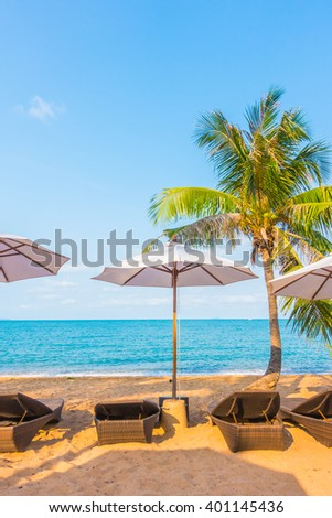 Umbrella and chair on the tropical beautiful beach and sea