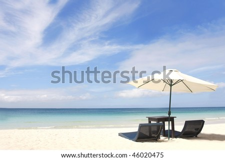 umbrella and chairs on sand beach - stock photo
