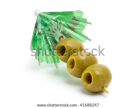 umbrella and green olives - stock photo