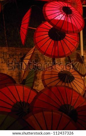 Umbrella at Laos night market - stock photo