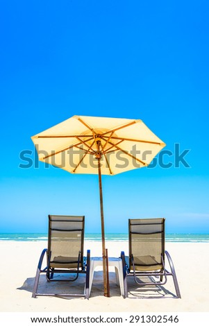 Umbrella beach chair on beautiful tropical beach